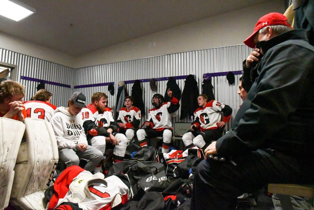 Glenwood Springs Demon Max Mecimer gives his teammates advice in the locker room during the intermission between the first and second period of Tuesday night's game against the Summit Tigers. Glenwood Springs Demon Hockey 2020