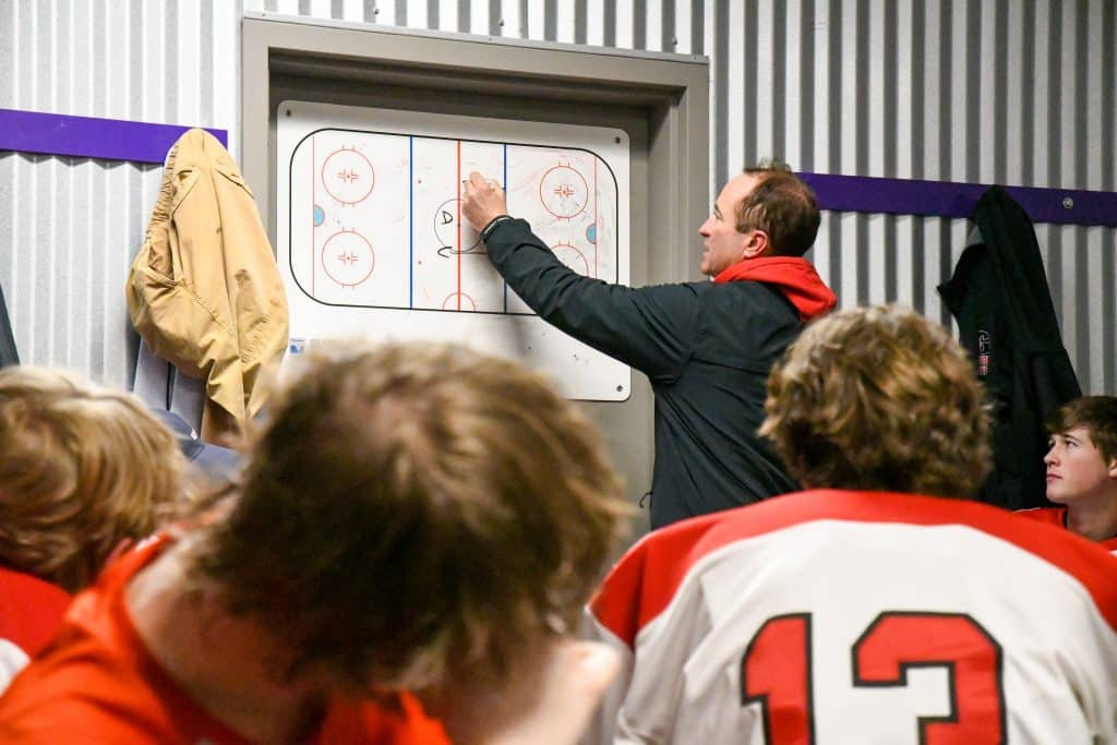 Glenwood Springs Demon Hockey coach Tim Cota talks strategy to his players in the locker room during the intermission between the first and second period of Tuesday night's game against the Summit Tigers. Glenwood Springs Demon Hockey 2020