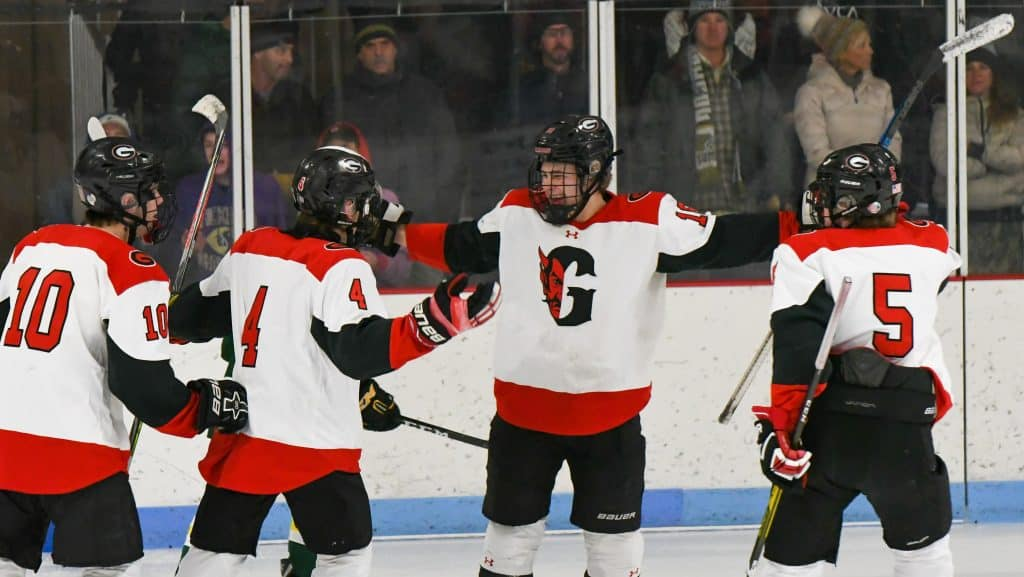 The Glenwood Springs Demons celebrate after scoring early in the first period of play against the Summit Tigers on Tuesday night. Glenwood Springs Demon Hockey 2020