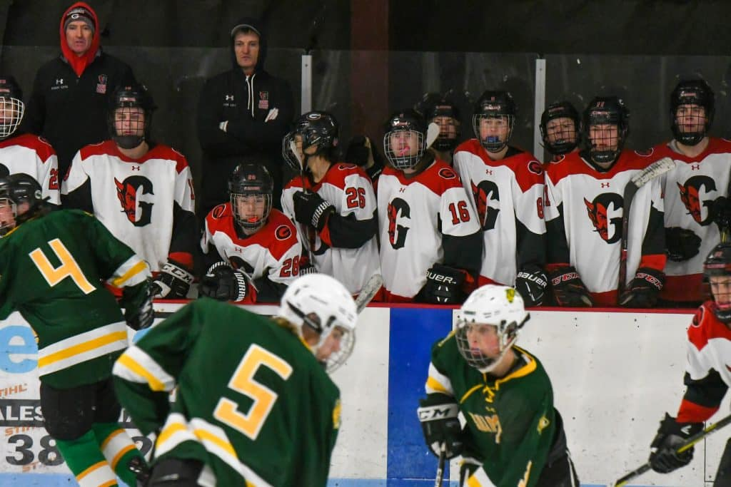 The Glenwood Springs Demon bench watch on as their teammates battle in overtime against the Summit Tigers on Tuesday night. Glenwood Springs Demon Hockey 2020
