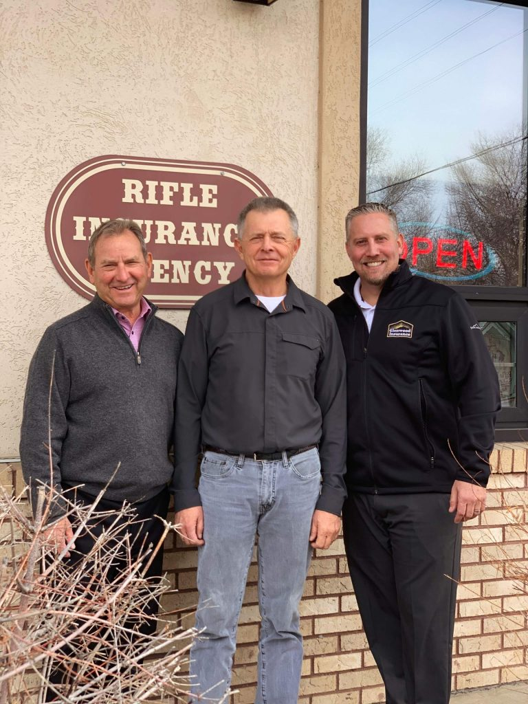 From left, Asa Jones, Jack Sours and Ian Exelbert pose in front of the Rifle Insurance office location.