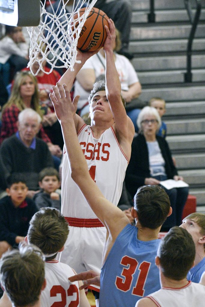 Glenwood's Mitchell Burt pulls up for a shot over Weld Central's Daniel Begler during first quarter play Saturday. The Demons prevailed 55-30 to advance in the 4A playoffs.
