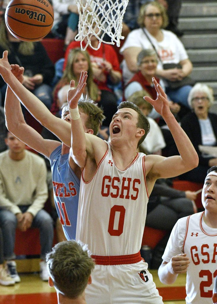 Glenwood's AJ Adams battles for the rebound against Weld Central's Kevin Shaffer during first quarter action Saturday in Glenwood Springs. The Demons dominated the Rebels 55-30 to move on in the 4A playoffs and improve their record to 21-3 on the year.