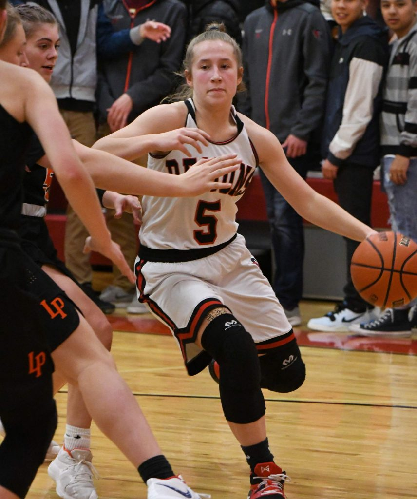 Glenwood Springs Demon Kenzie Winder dribbles the ball around the defending Lewis-Palmer Rangers during Friday night's playoff win.