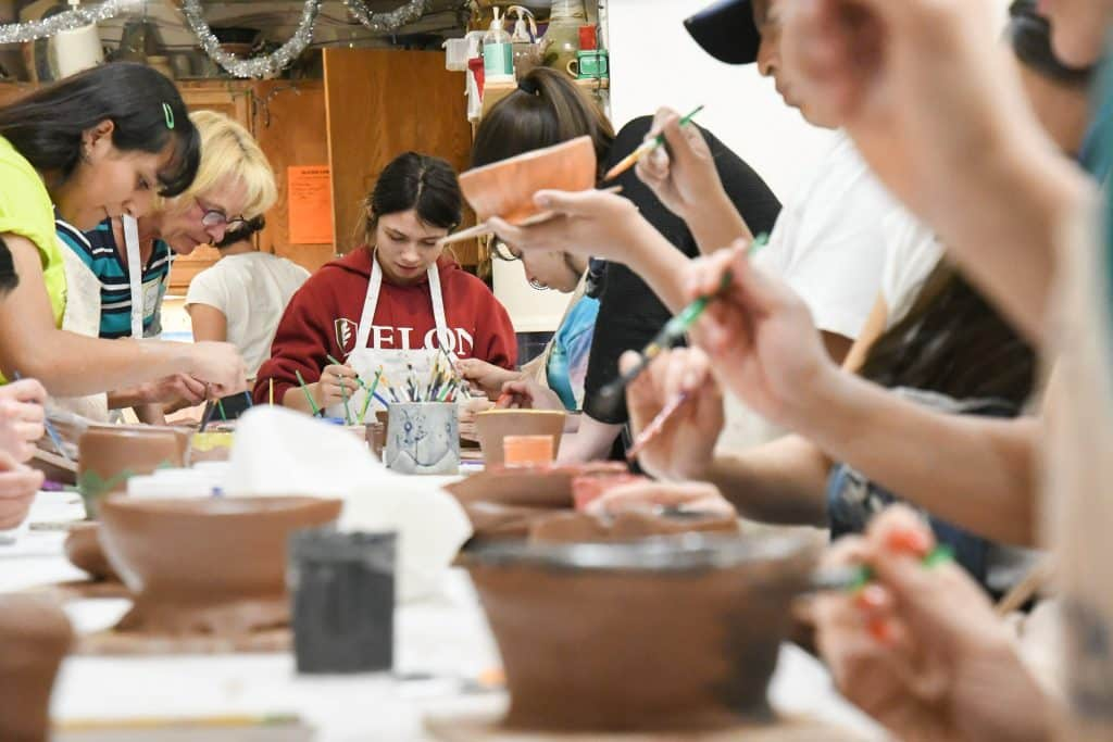 Buddy pairs hang out together at the Carbondale Clay Center on Monday evening making bowls. Buddy Program