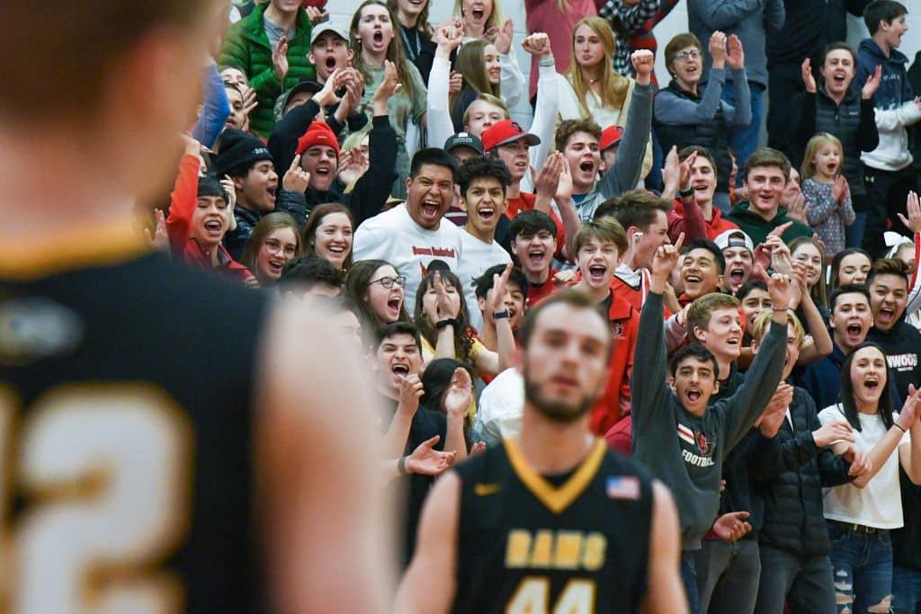 The Glenwood Springs High School student section react after a demon score at the buzzer to end the first half of play against the Green Mountain Rams on Wednesday night.