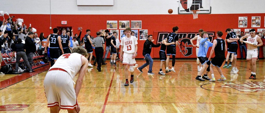 Defeat sinks in for Glenwood's seniors Mitchell Burt, Patrick Young and John Iuele as they leave the court for the final time after a 44-40 loss Saturday to Pueblo West.