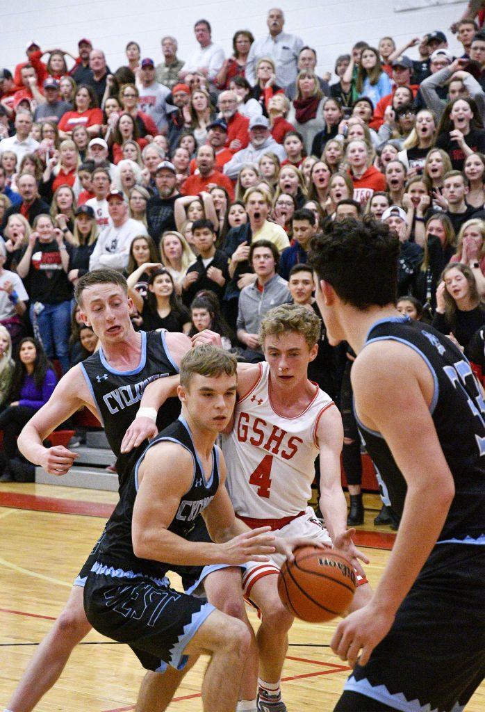 A stunned crowd can only watch as Pueblo West's Zachary Reid takes control of the ball after a shot attempt by Glenwood's Mitchell Burt with less than 20 seconds in the fourth quarter Saturday night. The Demons came up short as the Cyclones took the victory 44-40, ending Glenwood's season.