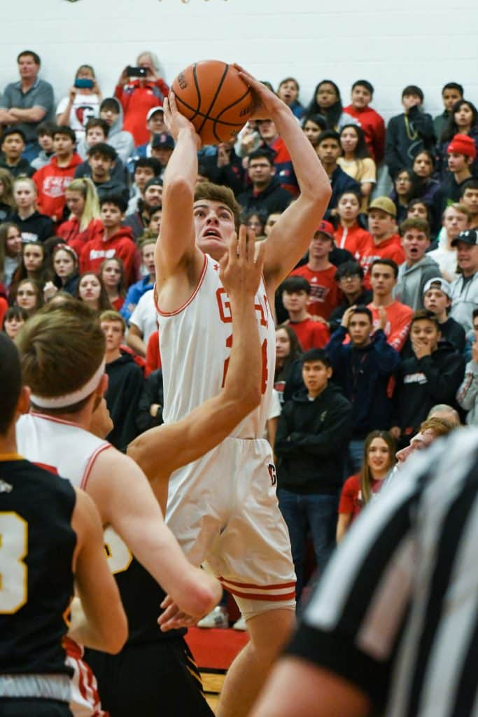 Glenwood Springs Demon Blake Nieslanik jumps for two points during Wednesday night's playoff game against the Green Mountain Rams.