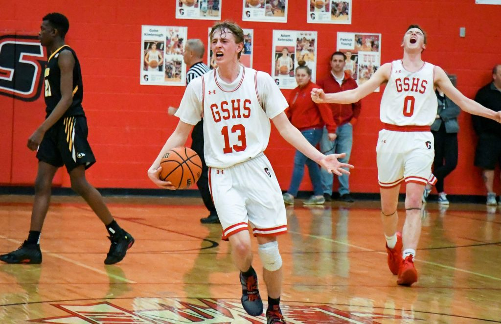Glenwood Springs Demons Patrick Young and AJ Adams celebrate after defeating the Green Mountain Rams during Wednesday night's 56-50 Class 4A state playoff win.