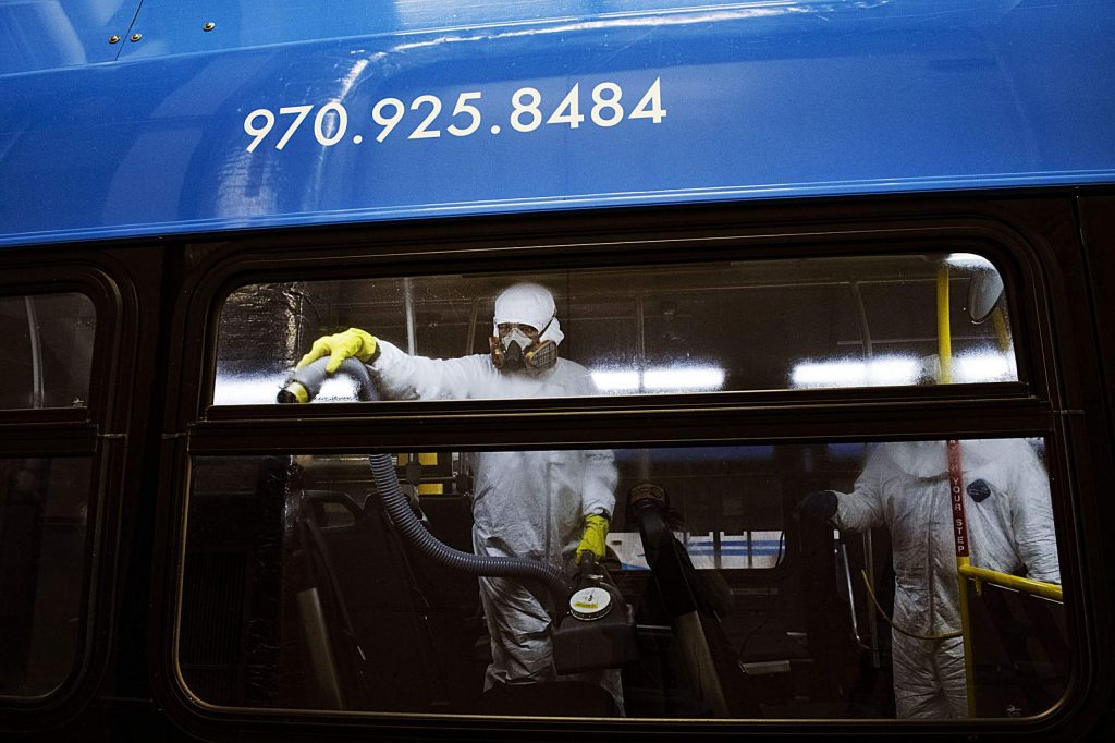 RFTA employee Patricia Rosales Trigo, left, and lead mechanic Will Fabela disinfect a bus at the Aspen Maintenance Facility on Thursday, March 12, 2020. (Kelsey Brunner/The Aspen Times)