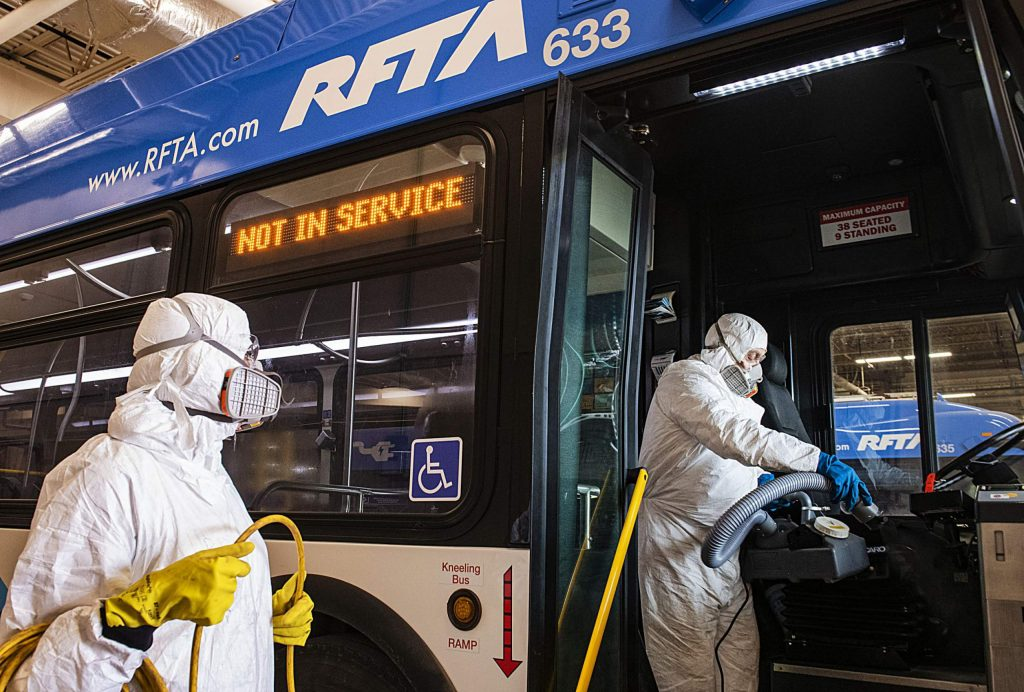 RFTA lead mechanic Will Fabela, right, and Patricia Rosales Trigo disinfect a bus at the Aspen Maintenance Facility on Thursday, March 12, 2020. (Kelsey Brunner/The Aspen Times)
