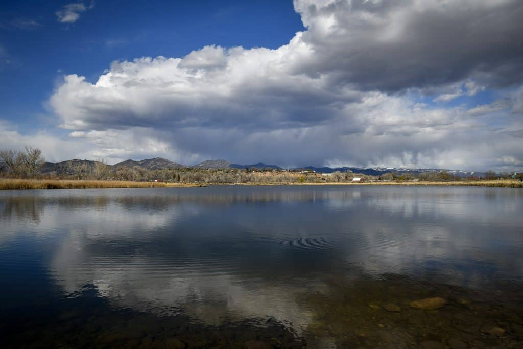 Storm clouds are relected in the Rifle Ponds as it passes to the north Rifle Tuesday afternoon. The forecast is calling for continuing warm weather, with highs in the 70s this weekend. (Kyle Mills / Citizen Telegram)