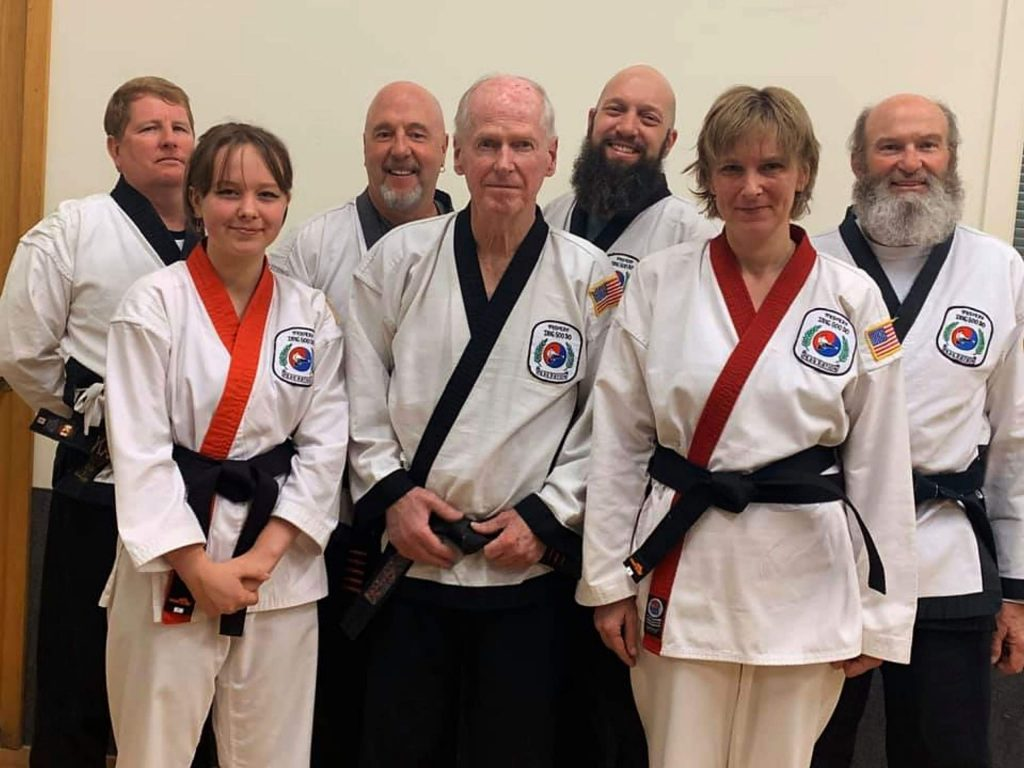 Gabi and Joanna with WTSDF examiners, from left, Ted Klokman, Dave Malehorn, Brian Mable, Dave Clark and Ken Newton.