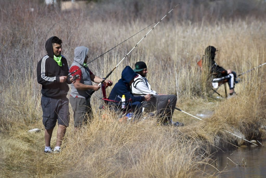 Tuesday's 60 degree temperatures had residents flocking to the Rifle Ponds testing their luck try to snag the catch of the day.