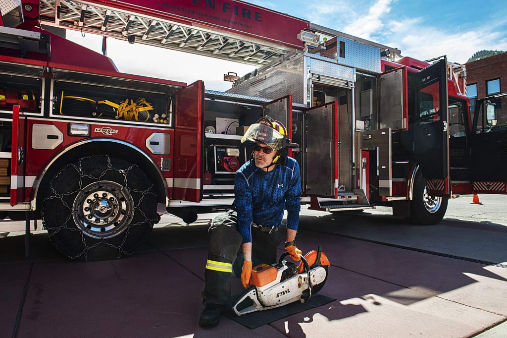 Aspen Volunteer Fire Department captain Sandy Schiff runs truck checks outside of the fire house on Thursday, March 26, 2020. Schiff has been with the department for about six years. (Kelsey Brunner/The Aspen Times)