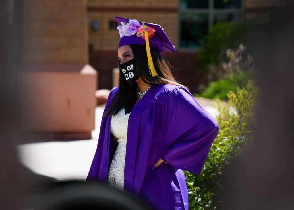 A Yampah Mountain High School graduate listens in as her advisor says a few words about her at the drive-in graduation ceremony on Friday morning.