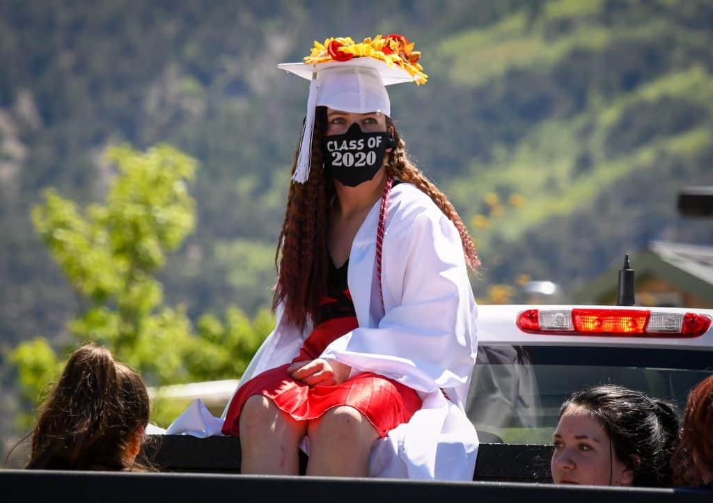 A Yampah Mountain High School graduate waits in line at the drive-in graduation ceremony on Firday morning.