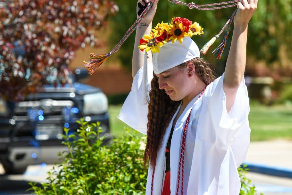 A Yampah Mountain High School graduate recieves a special graduation cord at the drive-in ceremony on Friday morning.