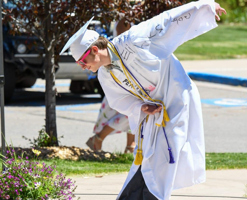 A 2020 Yampah Mountain High School graduate bows for the crowd at the drive-in graduation ceremony on Friday morning.