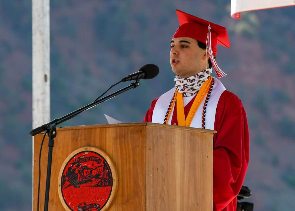 Glenwood Springs High School class of 2020 valedictorian William Haas addresses his classmates at the drive-in graduation ceremony held at the Glenwood Springs Municipal Airport on Saturday morning.