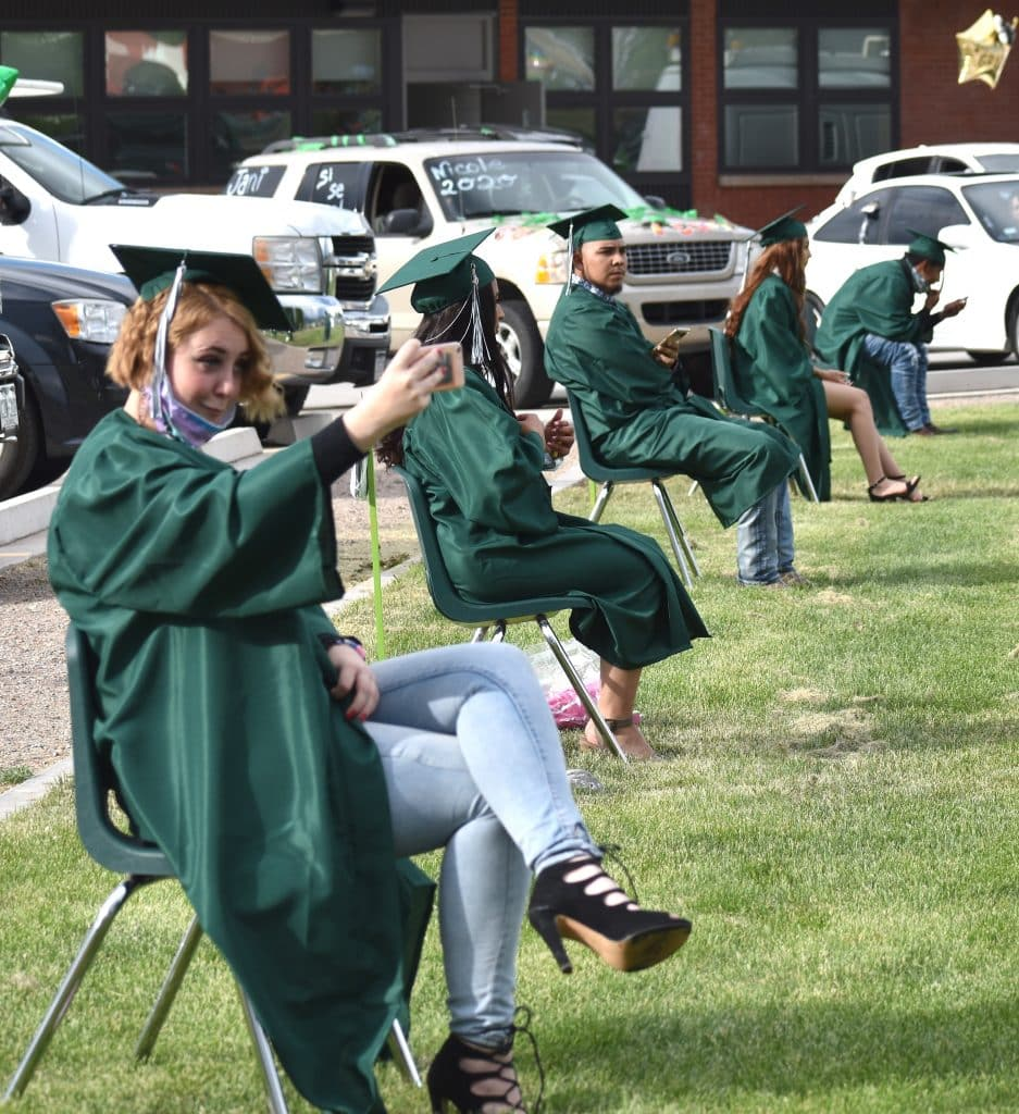 Bridges High School graduate Chey French takes a selfie before the start of the school's graduation ceremony in Carbondale Friday evening.