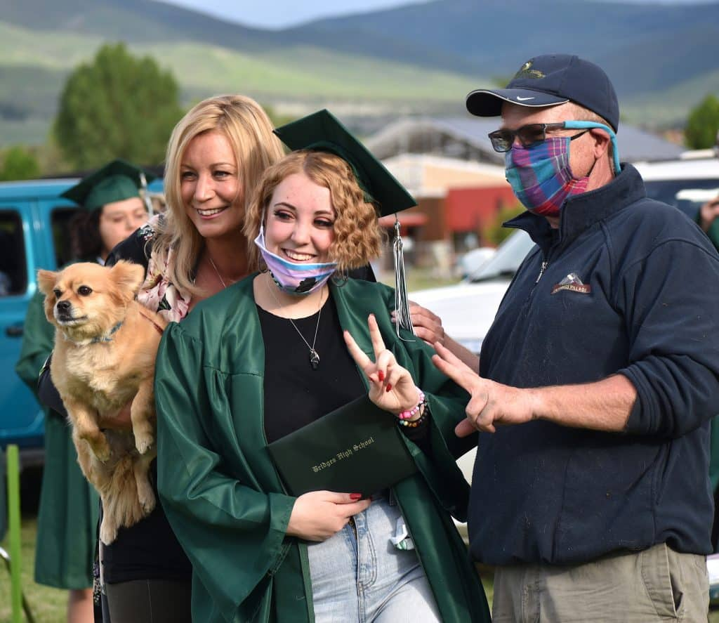 Family photo time for Bridges graduate Chey French Friday evening in Carbondale.
