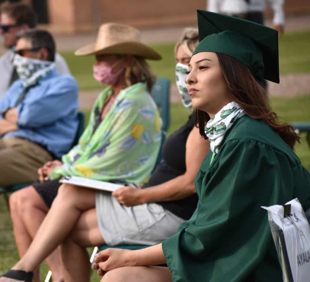 Bridges High School graduate Jessica Ayala takes in the celebration during her school's graduation ceremony Friday evening in Carbondale.