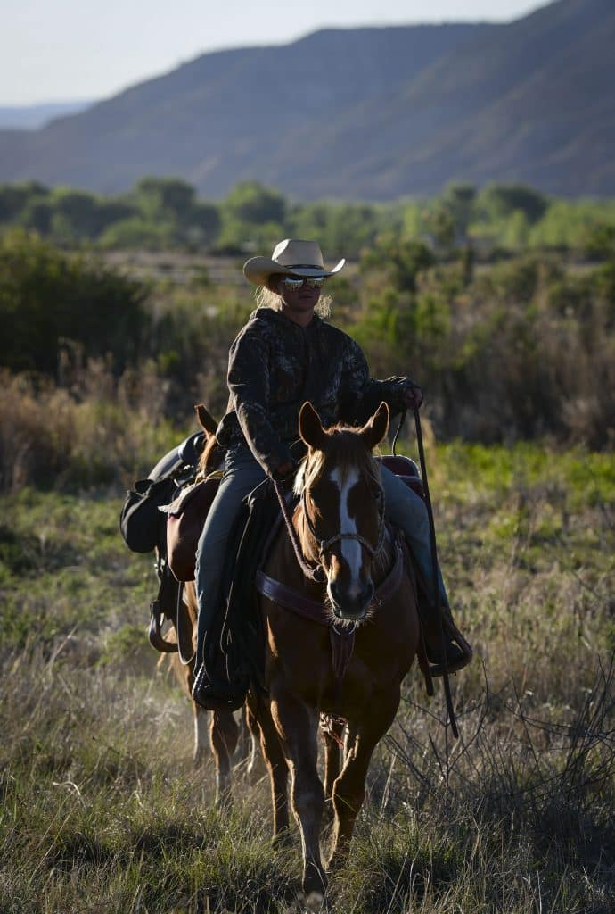 April Ramthun brings the horses back to the camp as they prepare to start the drive last Thursday west of Rifle.