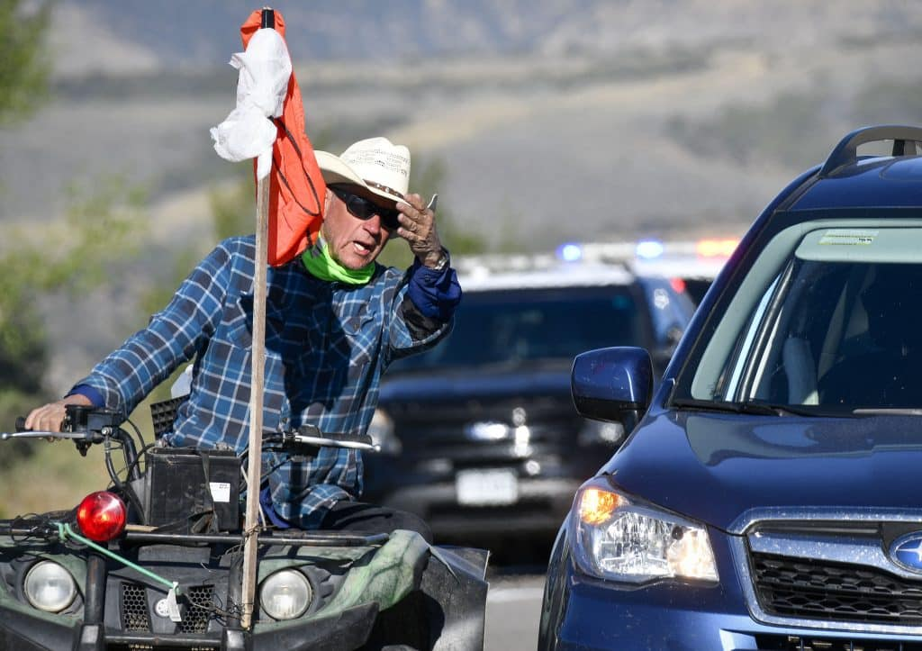 With the help of a 4-wheeler Dan McQueen scouts out the route through the intersection of Railroad Avenue and Highway 6 before the herd arrives.