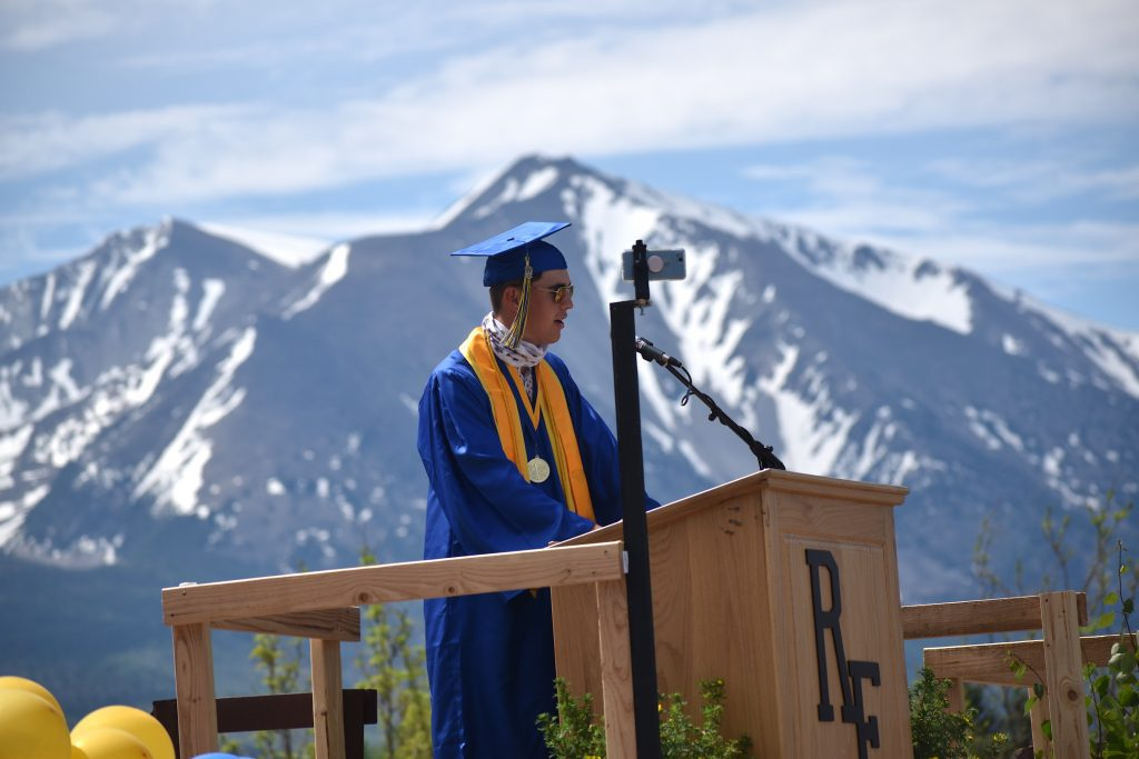 Roaring Fork High School class of 2020 co-valedictorian Rex Hamilton addresses his fellow graduates during the drive-in ceremony Saturday morning in Carbondale.