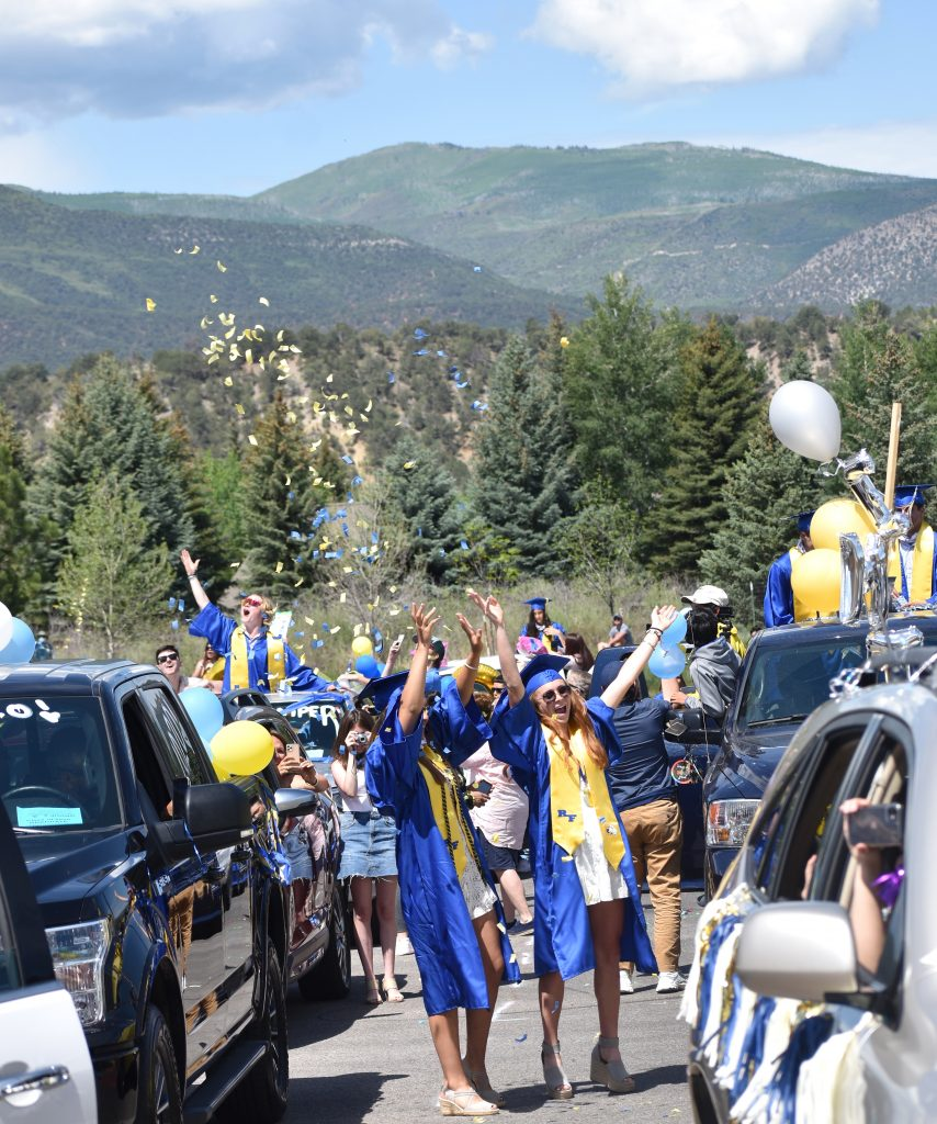Members of the Roaring Fork High School graduating class of 2020 celebrate with confetti after the drive-in ceremony in Carbondale Saturday morningl.