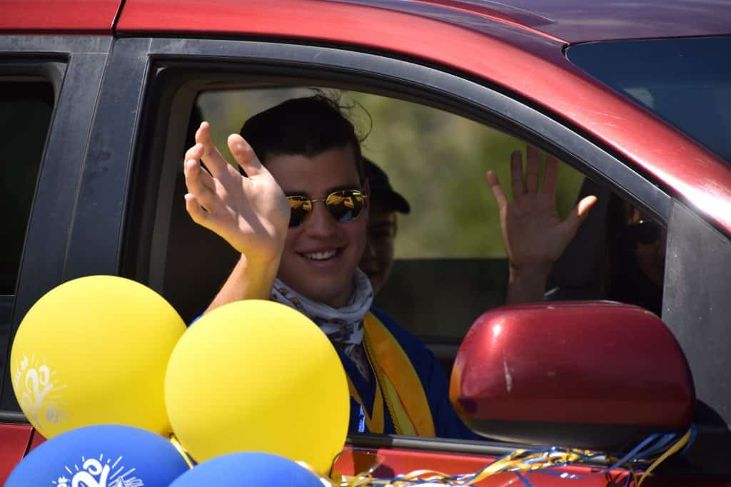 Roaring Fork High School class of 2020 co-valedictorian Rex Hamilton rides in the celebratory parade after the Saturday morning ceremony.
