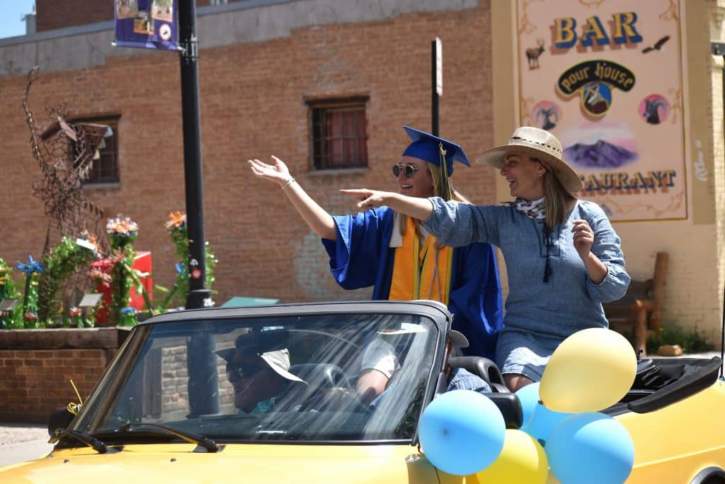 Roaring Fork High School class of 2020 co-valedictorian Lucia Penzel and her mom Liz Penzel in the celebratory parade down Main Street in Carbondale Saturday morning.