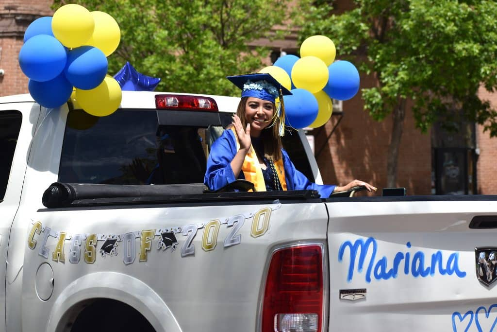 Roaring Fork High School graduate Mariana Cortes rides in the celebratory parade down Main Street in Carbondale Saturday morning.
