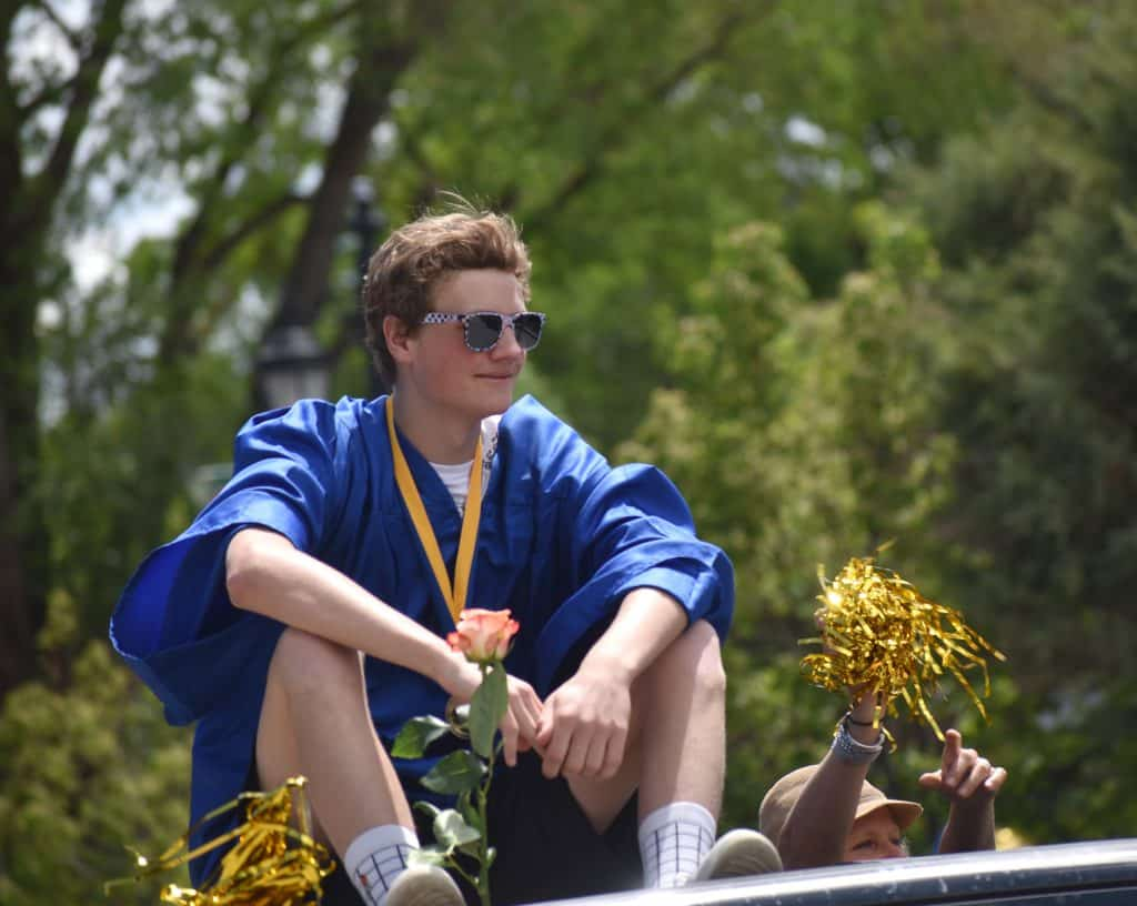 Roaring Fork High School graduate Aiden Foote rides in the celebratory parade down Main Street Saturday morning.