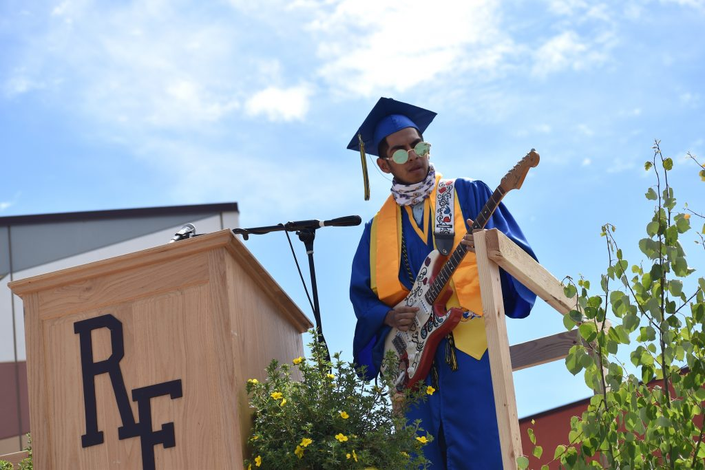Diego Valdez plays the National Anthem on his guitar to begin the 2020 Roaring Fork High School drive-in graduation ceremony Saturday morning in Carbondale.