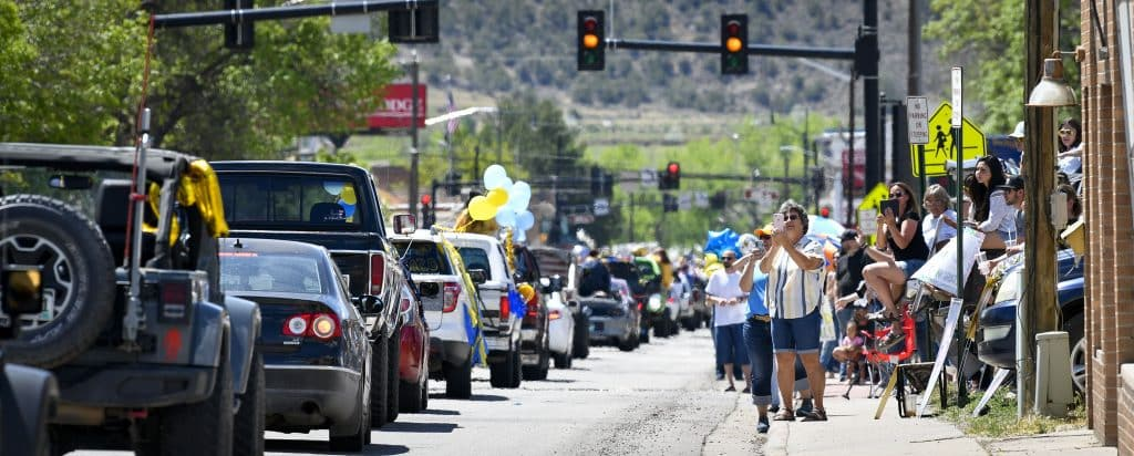 Family, friends and community members line Railroad Avenue as the Rifle High School Class of 2020 processional makes its way through town last Saturday.