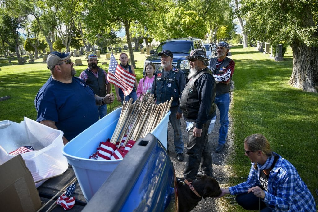With the help from volunteers Americna Legion Post 78 in Rifle prepare to add flags to veterans graves at Rose Hill Cemetery last Thursday.