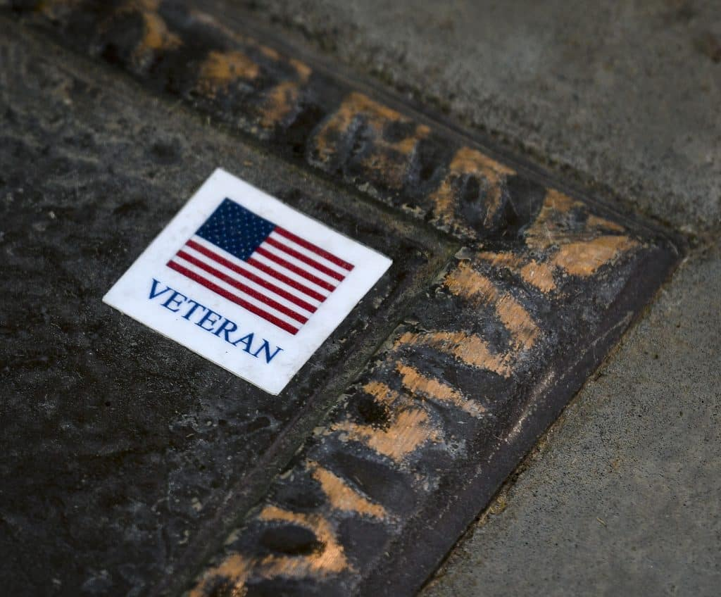 A sticker acknowledges a veteran buried at Rose Hill Cemetery in Rifle.