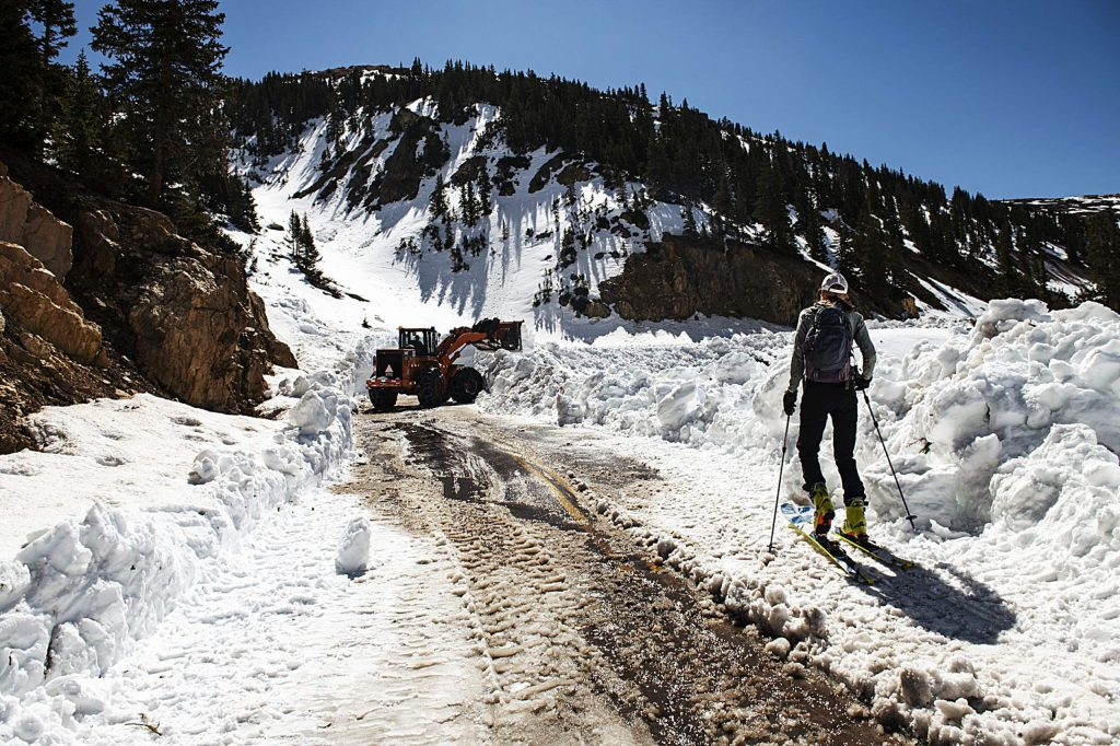 Independence Pass Foundation executive director Karin Teague skins up to where the road is being plowed on the west side of the pass on Tuesday, May 5, 2020. (Kelsey Brunner/The Aspen Times)