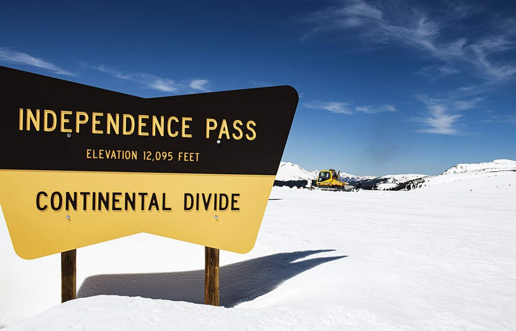 A CDOT snowcat plows up to the Independence Pass summit preparing for the summer traffic on Tuesday, May 5, 2020. (Kelsey Brunner/The Aspen Times)