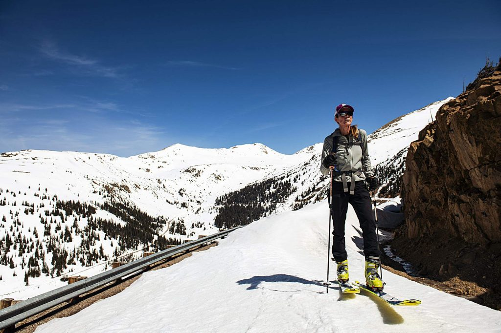 Independence Pass Foundation executive director Karin Teague skins up the road towards the summit on Tuesday, May 5, 2020. (Kelsey Brunner/The Aspen Times)