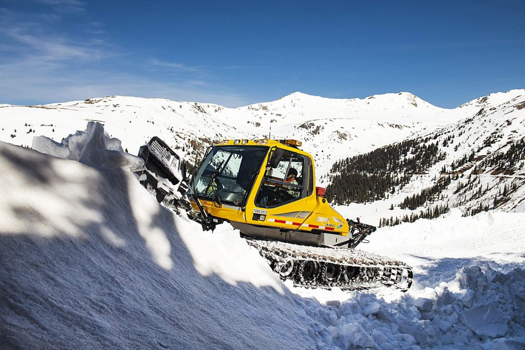 A CDOT snowcat works on the west side of Independence Pass to prepare for an early June opening on Tuesday, May 5, 2020. (Kelsey Brunner/The Aspen Times)