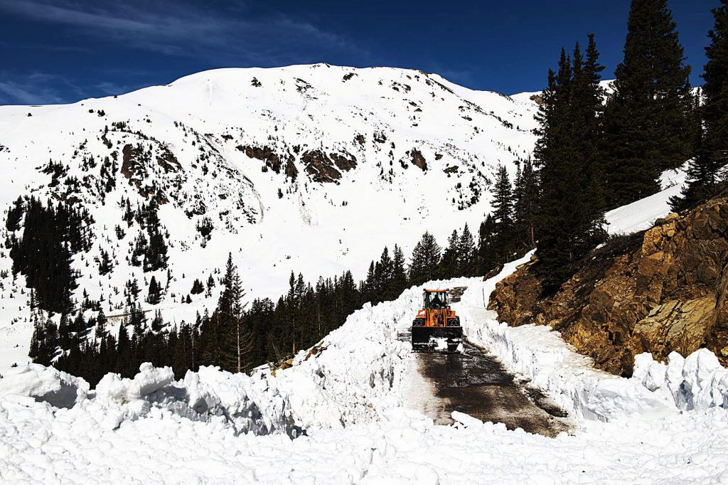 A CDOT plows where the cleared road ends on the west side of Independence Pass on Tuesday, May 5, 2020. (Kelsey Brunner/The Aspen Times)
