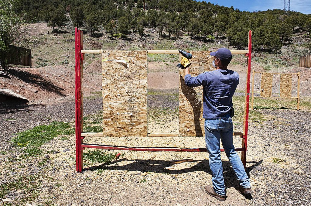 Colorado Parks and Wildlife seasonal technician Layton Stutsman removes used target boards while the Basalt Pistol Range is closed on Thursday, May 28, 2020. (Kelsey Brunner/The Aspen Times)