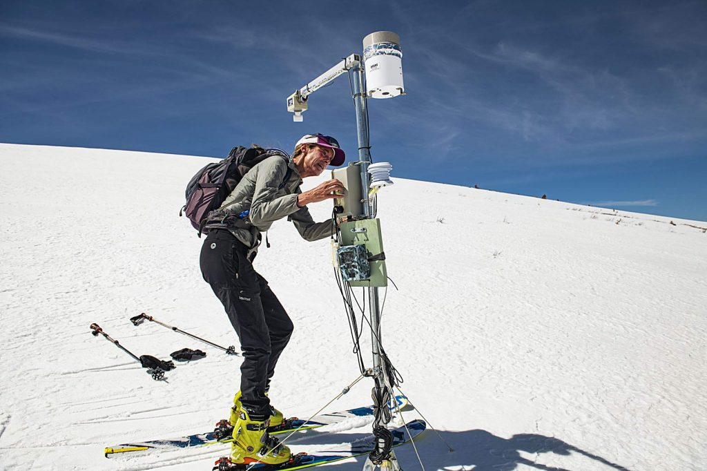 Independence Pass Foundation executive director Karin Teague resets the weather monitoring station near the summit of Independence Pass on Tuesday, May 5, 2020. (Kelsey Brunner/The Aspen Times)