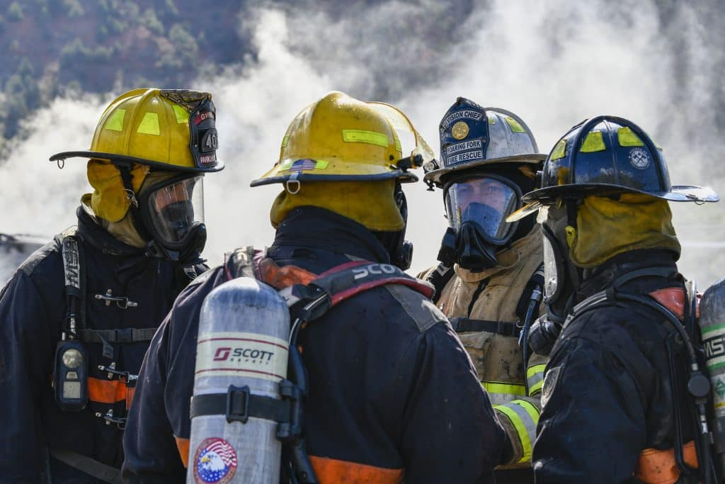 Terry Cox, division chief from Roaring Fork Fire Resuce debriefs CMC Rifle Fire Academy cadets after they extinguish a car fire during last Sunday's burn day in Glenwood Springs.