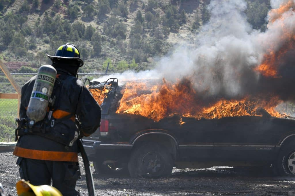 Cadets take their positions as they prepare to attack a fully engulfed car fire during last Sunday's bunr day in Glenwood.
