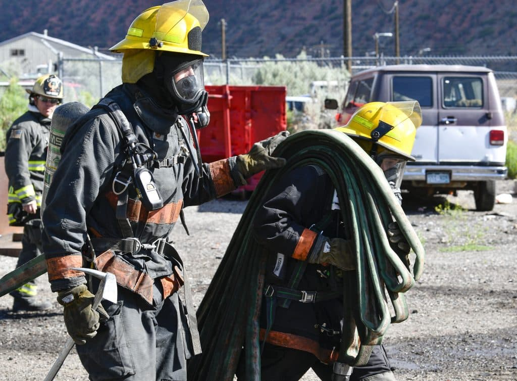Scott Van Slyke, battalion chief with Colorado River Fire Resuce, closely watches cadets approach a car fire last Sunday's burn day in Glenwood Springs as part of the CMC Fire Academy.